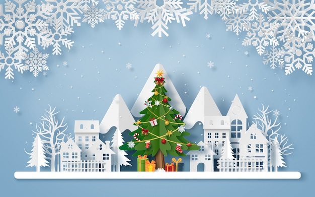 Origami paper art of christmas tree in the village with the mountain Premium Vector