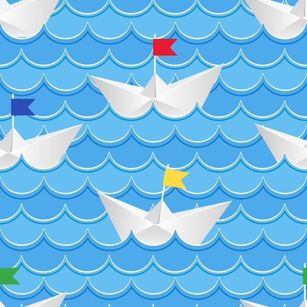 Оригами бумажные кораблики на голубой бумажной воде. Бесплатные векторы