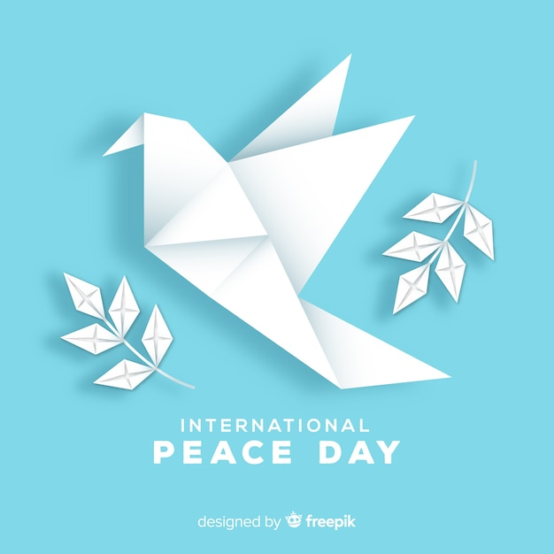 Origami peace day background with dove Free Vector