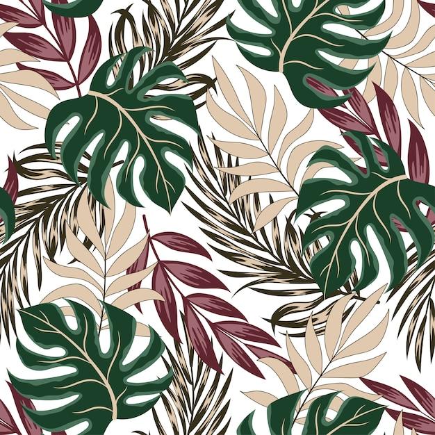 Оригинальный тропический бесшовный узор с яркими листьями и растениями на белом фоне Premium векторы