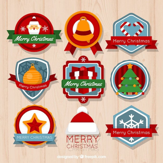 Ornamental christmas badges in flat\ design