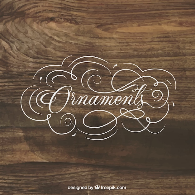 Ornaments lettering on wood background vector free download