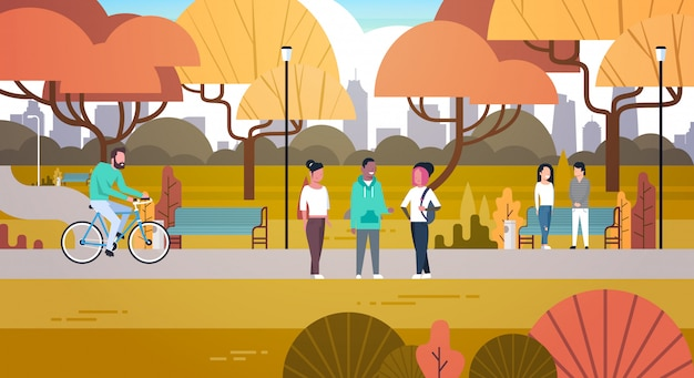 Outdoor park activities, people relaxing in nature walking riding bicycle and communicating Premium Vector