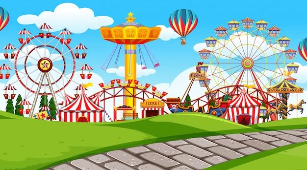 Outdoor scene with amusement park Free Vector