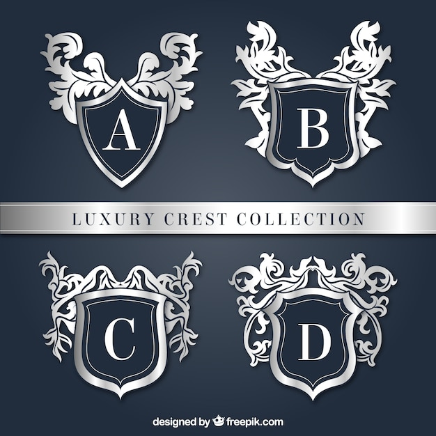 Pack of four elegant shields Free Vector