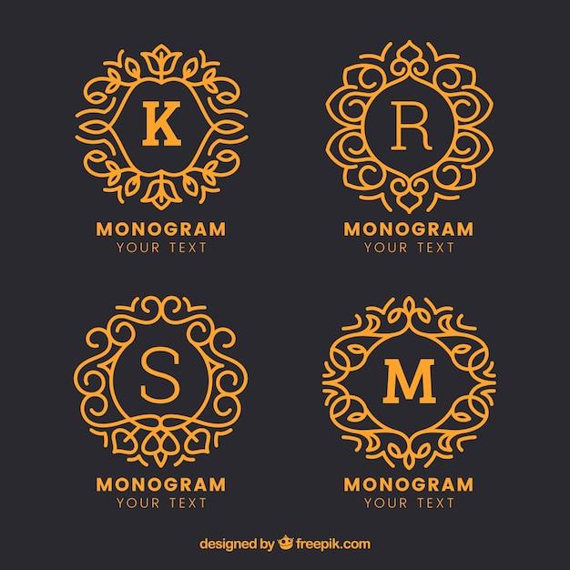 Confezione di monogrammi disegnati a mano d'oro Vettore gratuito