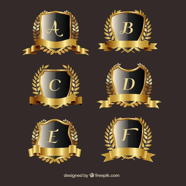 Pack of golden crests with laurel wreath Free Vector