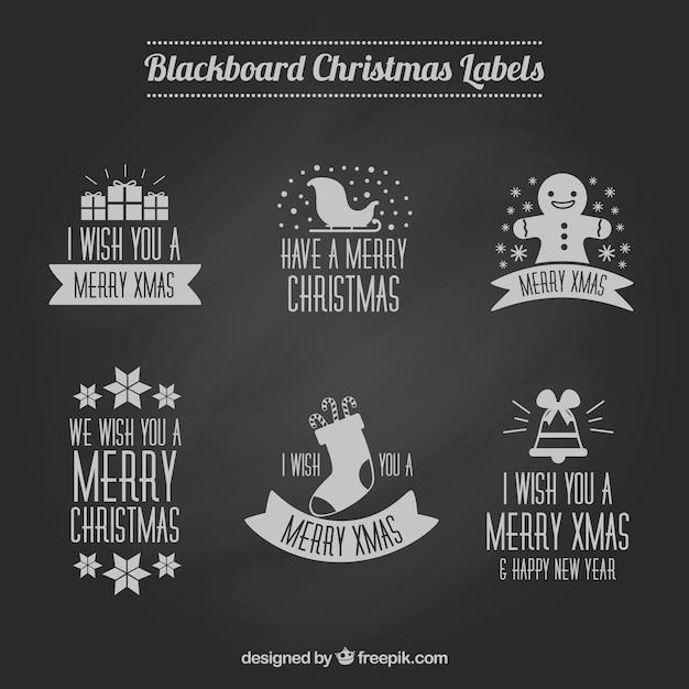 Pack of christmas badges on blackboard effect
