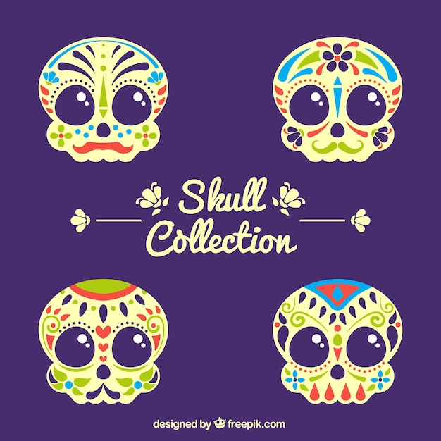 Pack of colored ornamental skulls Free Vector