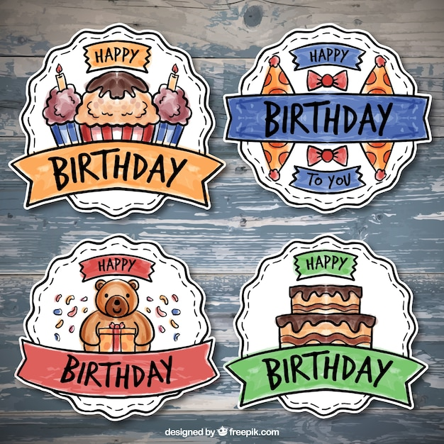 Pack of four colorful birthday badges in watercolor style