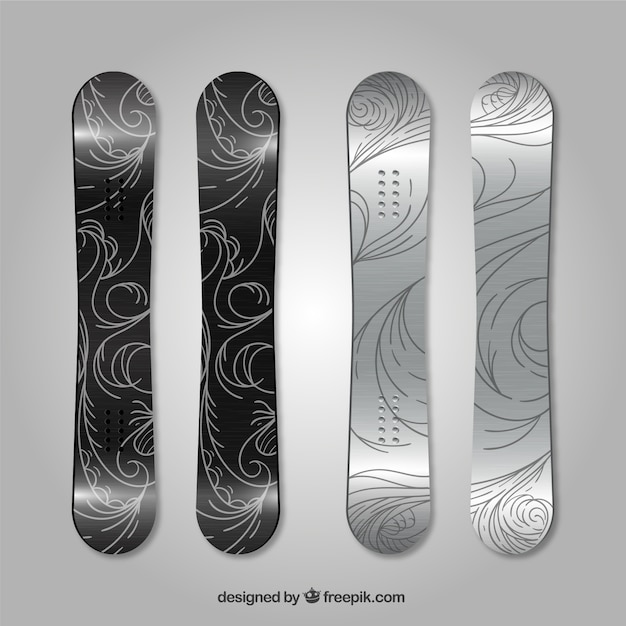 Pack of four snowboards with abstract\ designs