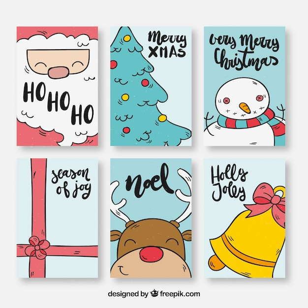 pack of six christmas cards with drawings free vector