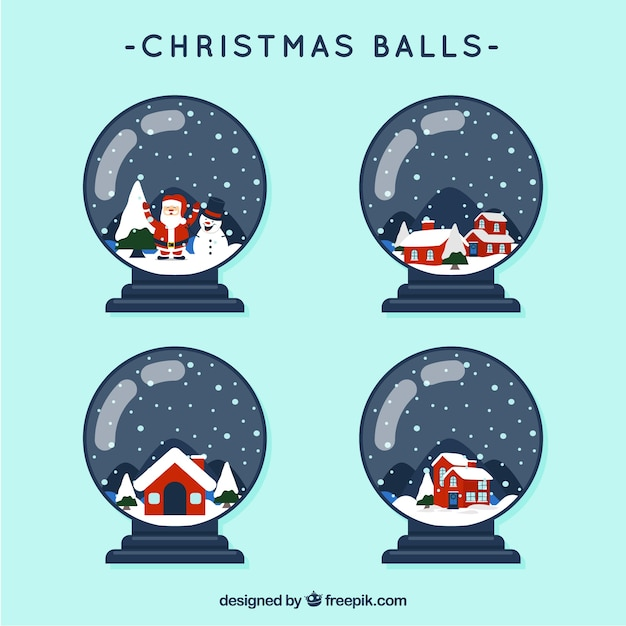 Pack of snowballs with houses Free Vector