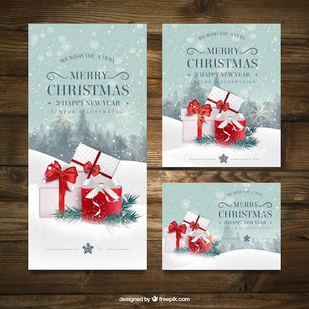 Pack of three christmas card with different sizes Free Vector