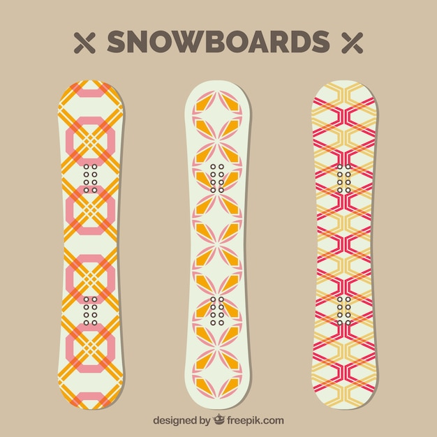 Pack of three snowboards with geometric\ designs