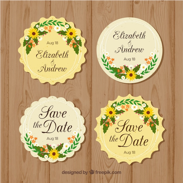 Pack of round floral wedding badges Free Vector