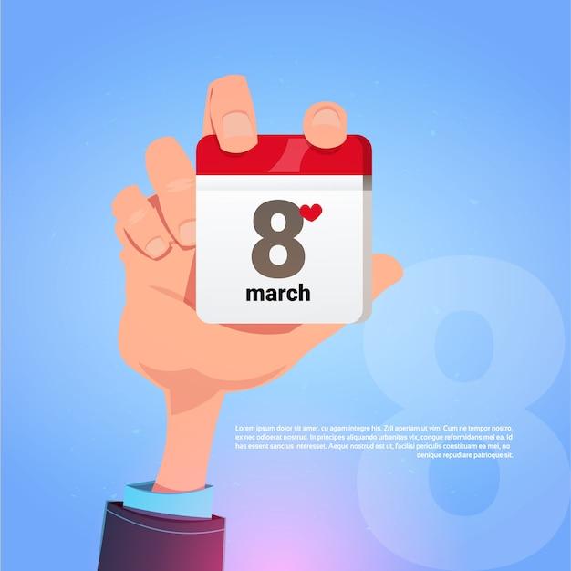Мужская рука с календарем page 8 8 марта дата счастливого международного женского праздника концепция Premium векторы