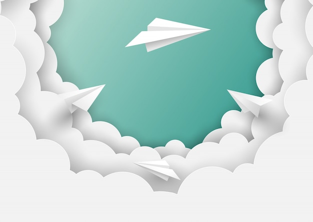 Paper airplanes flying on blue sky background Premium Vector