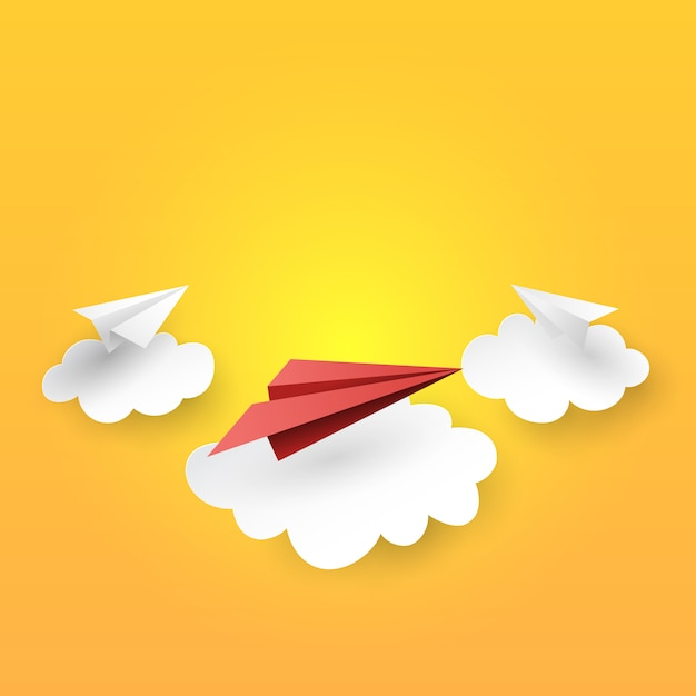 Paper airplanes flying on clouds background Premium Vector