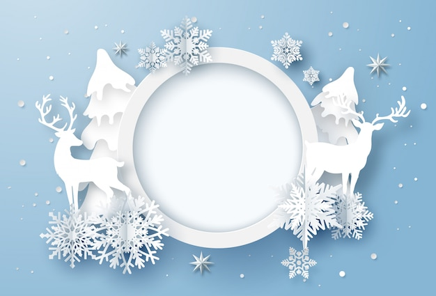 눈송이와 순록이 겨울 휴가 카드의 종이 예술 프리미엄 벡터