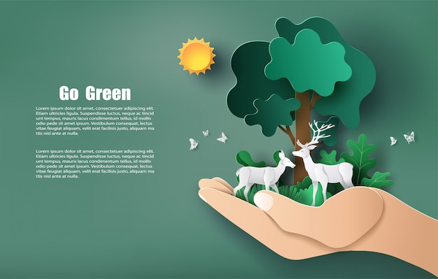 Paper art style of hand holding tree and plants with deers, save the planet and energy . Premium Vector