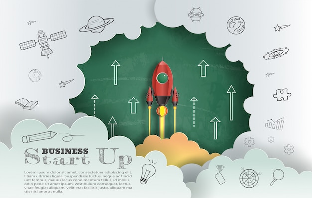 Paper art style of rocket flying with chalkboard background Premium Vector