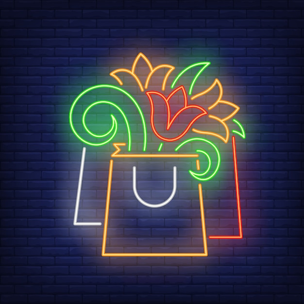Paper bag with flowers neon sign Free Vector