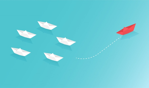 Paper boats represent of business teamwork and one different vision creative concept idea. Premium Vector