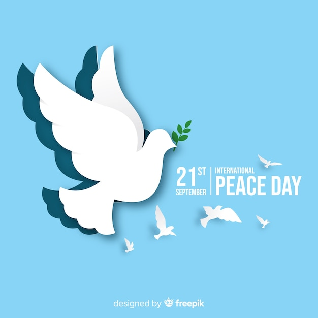 Paper peace day background with dove Free Vector