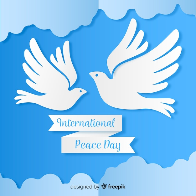 Paper peace day with dove and clouds Free Vector