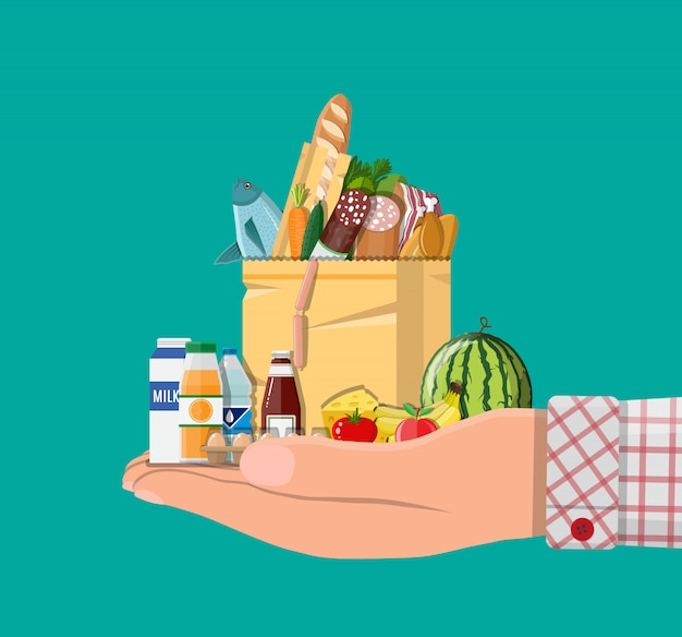 Paper shopping bag full of groceries products Premium Vector