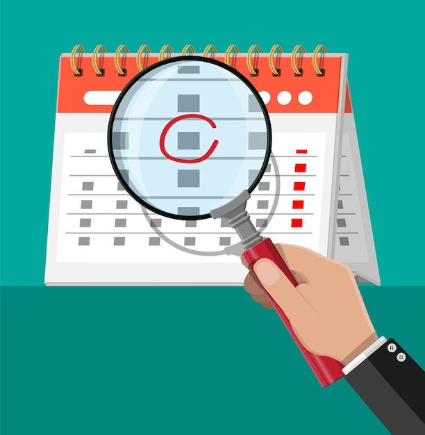 Бумажный спиральный настенный календарь и увеличительное стекло. Premium векторы