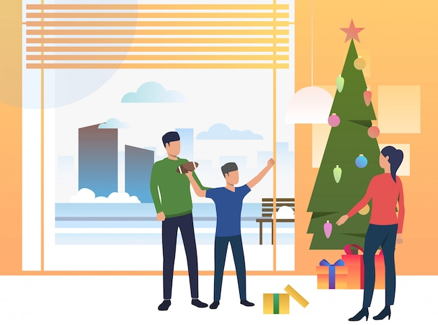 Parents and child giving xmas gifts Free Vector