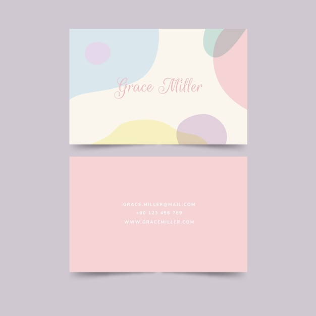 Pastel-coloured stains business card template Free Vector