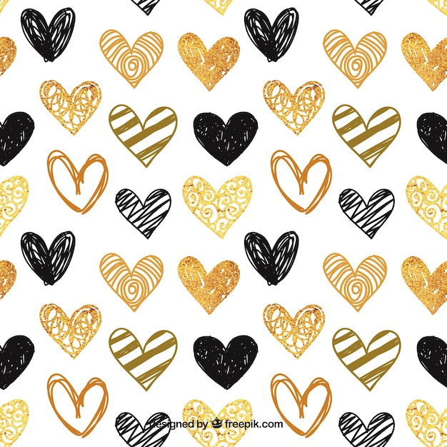 Pattern of hand-painted golden and black hearts Free Vector