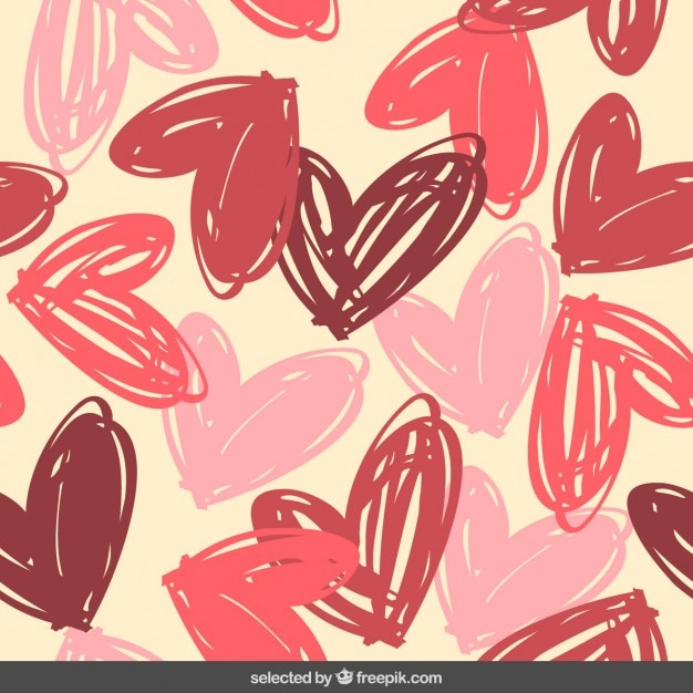Pattern with hand drawn hearts Free Vector
