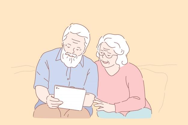 高齢者によるコンピューターの勉強。テクノロジーの普及、高齢者教育、活発な社会生活、オンラインコミュニケーション、タブレットを使用するシニアカップル、pcの併用学習。シンプルフラット Premiumベクター