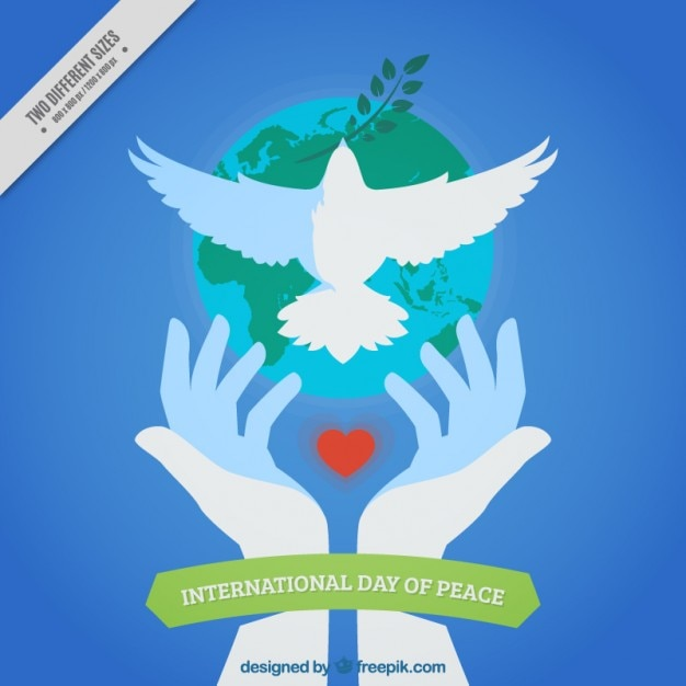 Peace day background of hands releasing a dove Free Vector