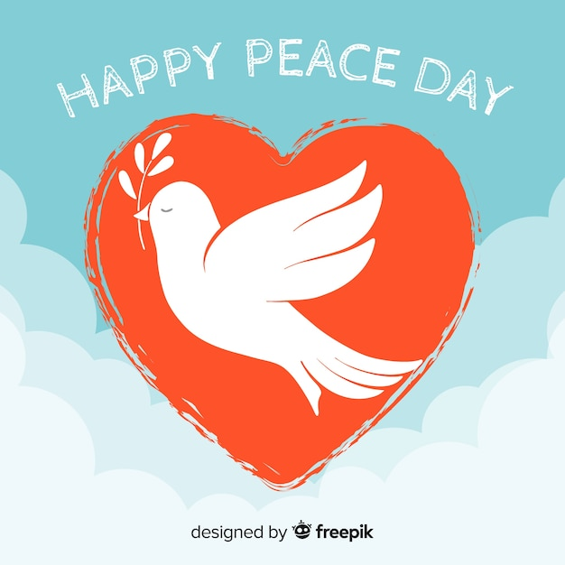 Peace day background with dove inside a heart Free Vector