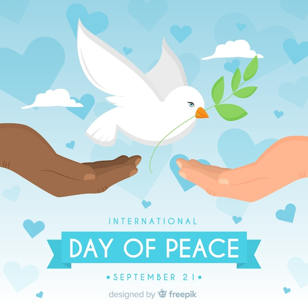 Peace day background with white dove and hands Free Vector