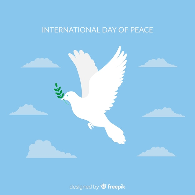 Peace day composition with flat white dove Free Vector