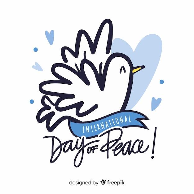 Concetto di giorno di pace con colomba disegnata a mano Vettore gratuito