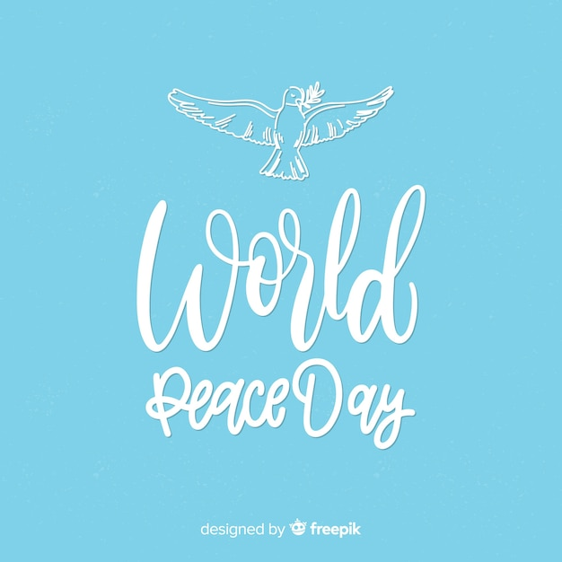 Peace day concept with lettering Free Vector