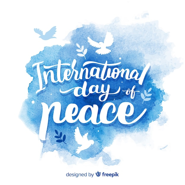 Peace day watercolor lettering background Free Vector