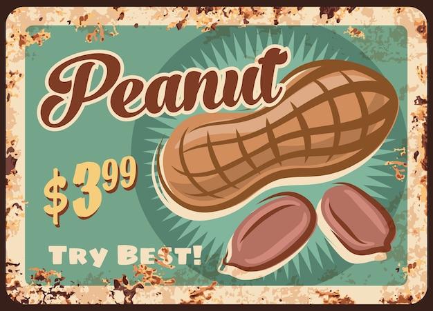 Металлическая пластина арахиса ржавая, знак ржавчины свежего земляного ореха винтажный. Premium векторы