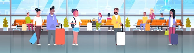 People in airport travelers with baggage at waiting hall Premium Vector