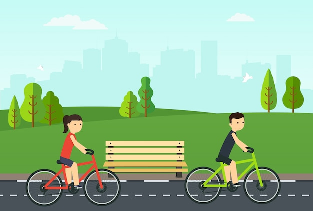 People on bikes ride in the city park. Premium Vector