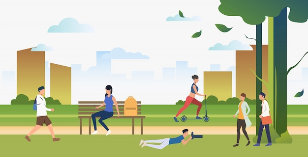 People doing sports and relaxing in city park Free Vector