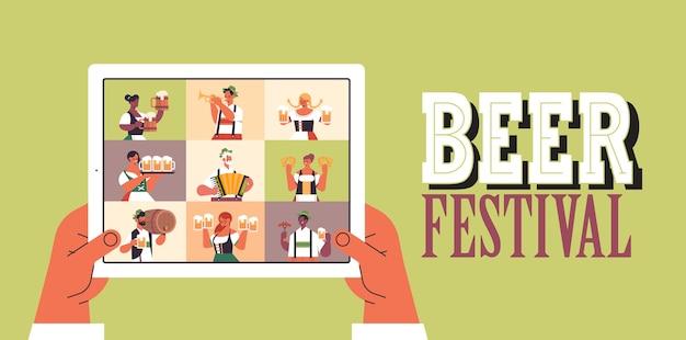 People on tablet screen celebrating oktoberfest party beer festival Premium Vector
