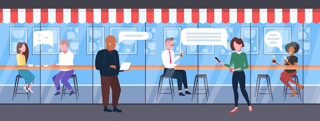 People using digital gadgets mobile chatting app chat bubble social media communication concept  men women having fun modern cafe exterior full length horizontal Premium Vector